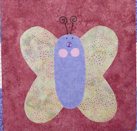 applique butterfly on a wall hanging
