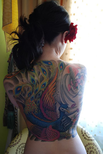 tatooed women peacock tattoo on back