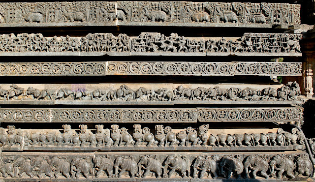 Elephants and lions on the first two rows followed by the floral designs and then the almost ruined horses, followed by another row of floral designs and then the episodes of Ramayana and Mahabharata, on the topmost row it must be kings  riding the Makaras .