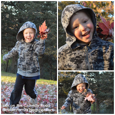 child playing in beautiful fall leaves