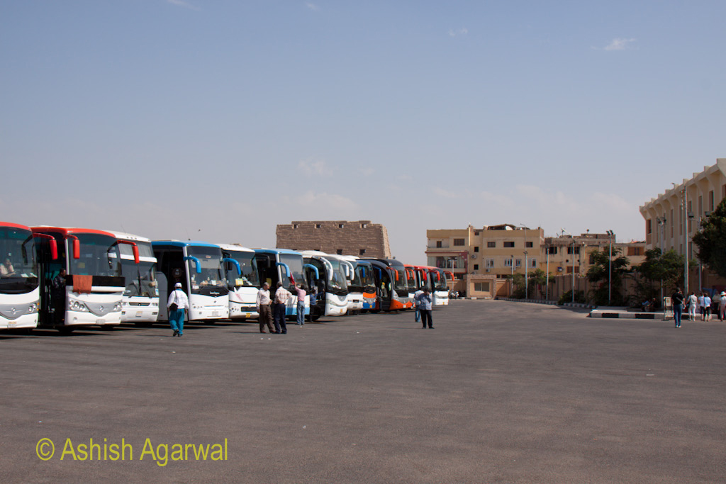 Buses parked outside the huge temple of Karnak in the city of Luxor