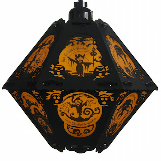 Orange and black classic hanging Halloween lantern with verse and ghouls ghosties