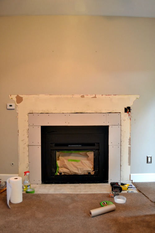 Family Room Update: The Green Wall is Dead! Plus, Furniture and Fireplace Progress