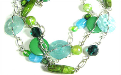 Long green necklace with elegant buttons, striking semi precious stones and faceted beads