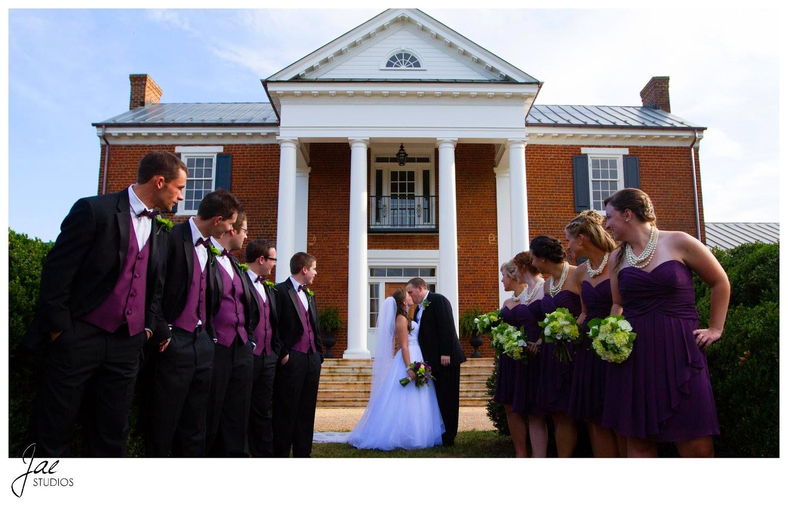 Jonathan and Julie, Bird cage, West Manor Estate, Wedding, Lynchburg, Virginia, Jae Studios, kissing, flowers, bouquet, boutonniere, purple, pearl, necklace