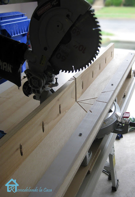 miter saw with jig to cut crown corners