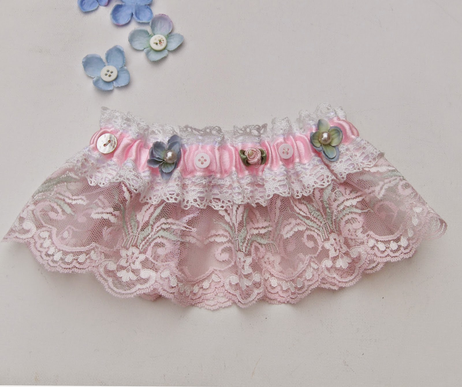 https://www.etsy.com/uk/listing/204103459/shabby-chic-wedding-bridal-garter-pink?ref=related-2