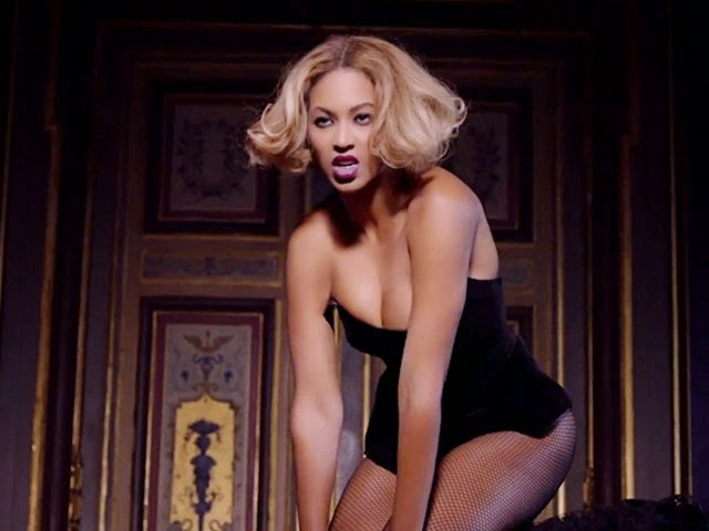 Beyonce in black dress performing Partition music video