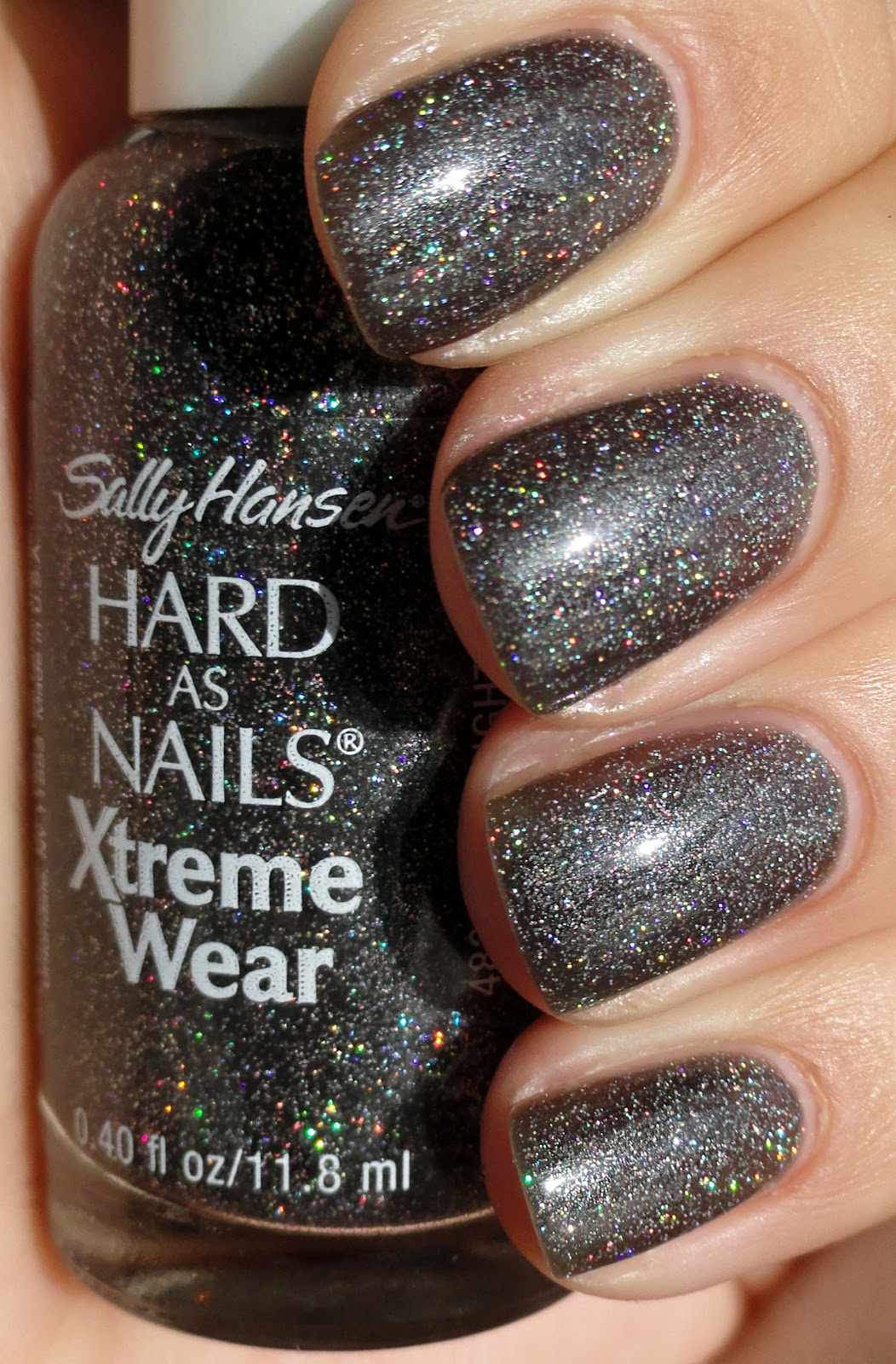 Sally Hansen Hard As Nails Xtreme Wear Night Lights Is A Really Ga Ga  Gorgeous Charcoal Grey Jelly Swimming With Holographic Glitter Pieces.