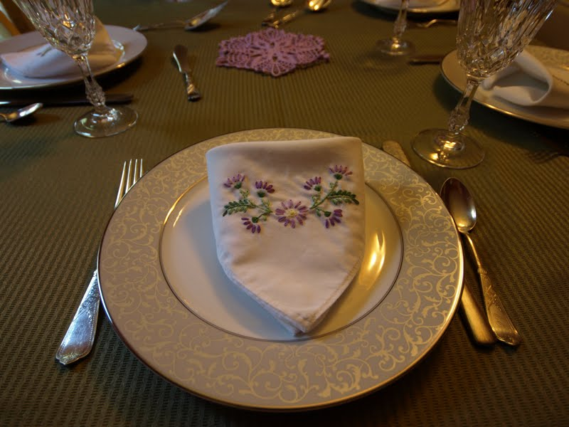 Purple and green on the dinner table plus silver wedding china
