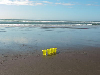 photo of buckets on the beach by Nancy Zavada