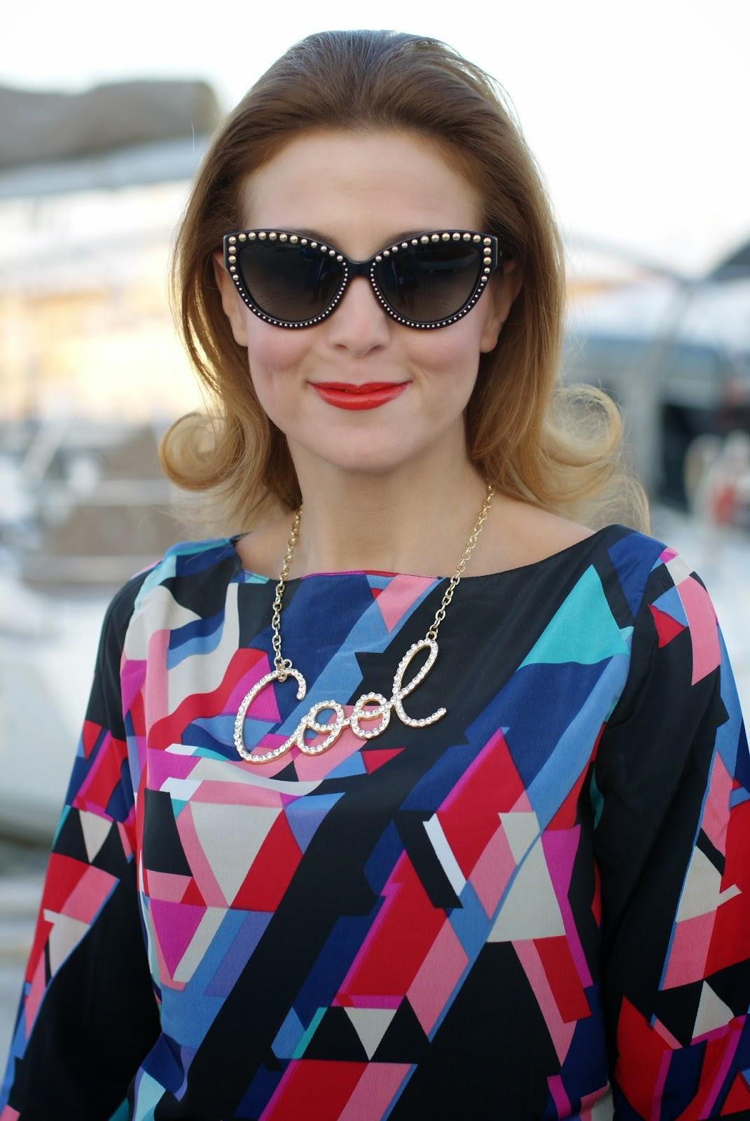 Paramita geometric print dress with Moschino studded cat eye sunglasses on Fashion and Cookies fashion blog