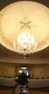 Samuel's Grand Manor's ballroom chandelier, a great venue for Buffalo, NY weddings.