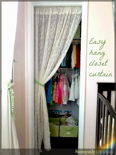 Hang a curtain in a small closet using cup hooks and a dowel