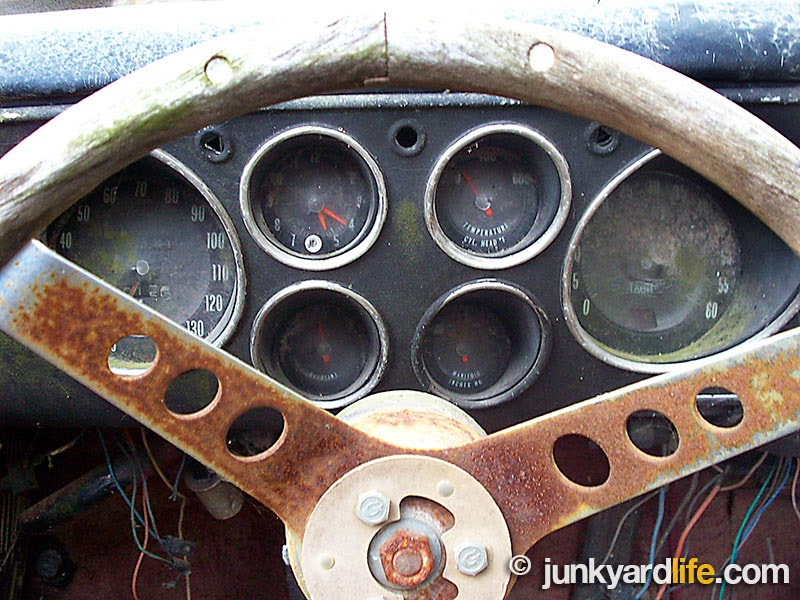 The Claymobile was built around and on a 1965 Corvair Corsa. Many parts including the 6-pod gauges were found intact on the Claymobile.