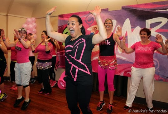 Lisa Halbert, Zumba Fitness Hawke's Bay, on stage with a group of Zumba instructors - Party in Pink Zumbathon, an event at the Hawke's Bay Opera House, Hastings, fundraiser to raise money towards the Zumba Global Research Grant for Breast Cancer Prevention photograph