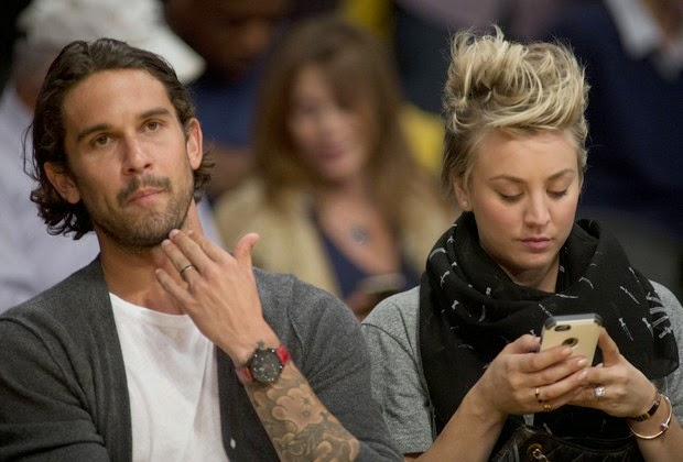 Kaley Cuoco at leisure stress: Multitasking at basketball game
