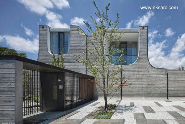 Casa de concreto contemporánea con techos curvos originales en Japón