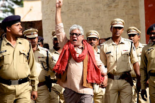 Veteran Indian actor Om Puri as the idealist Marxist Govind Suryavanshi, Chakravyuh (2012), Directed by Prakash Jha