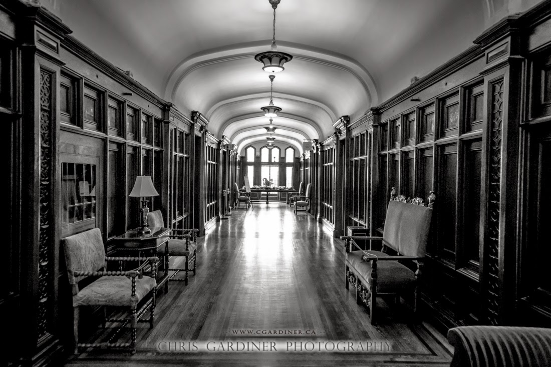 The upstairs hallway of Casa Loma in Toronto viewed in Monochrome captured by Chris Gardiner Photography with a canon dslr  www.cgardiner.ca.