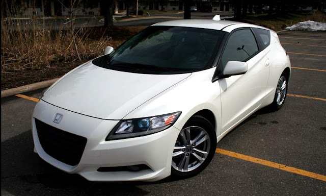 Front 3/4 view of white 2011 Honda CR-Z parked