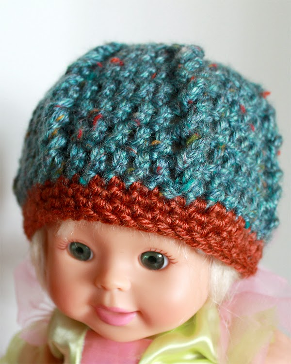 Crochet Cables Baby Beanie | A tiny cap for a brand new baby is a wonderfully satisfying and super quick crochet project. | The Inspired Wren