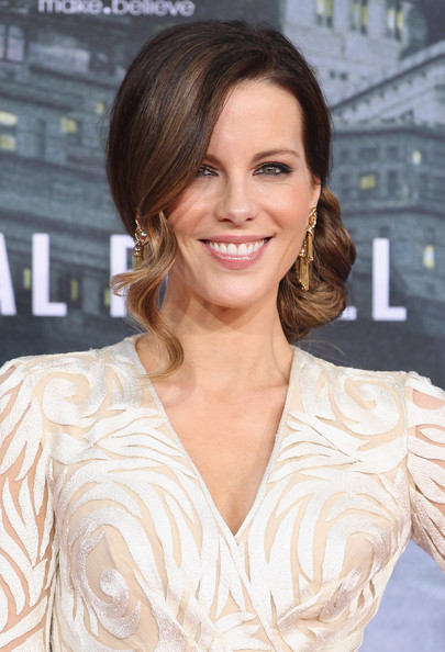 Kate Beckinsale's low chignon with a right-side fringe looks lovely on her face.