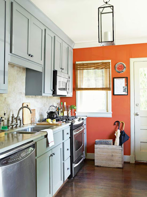 A Red Wall in A Simple Kitchen