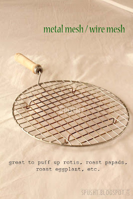 metal mesh or wire mesh with handle to roast papad and puff up roti