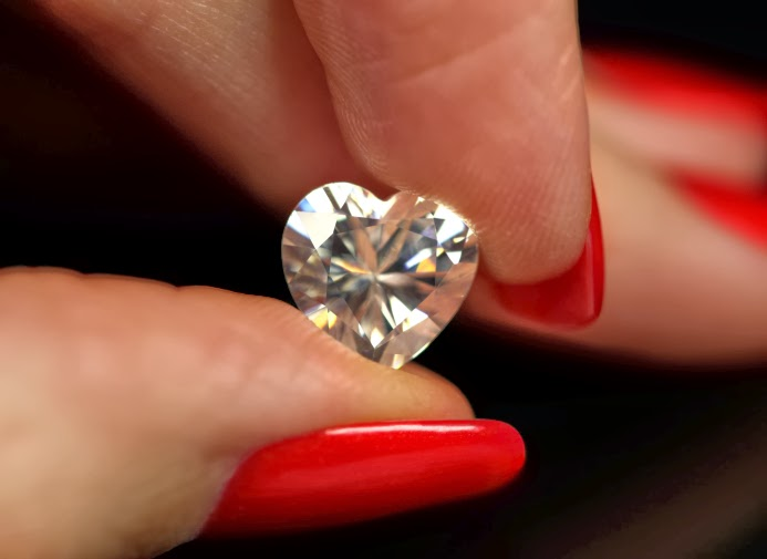 heart shaped diamond in fingertips