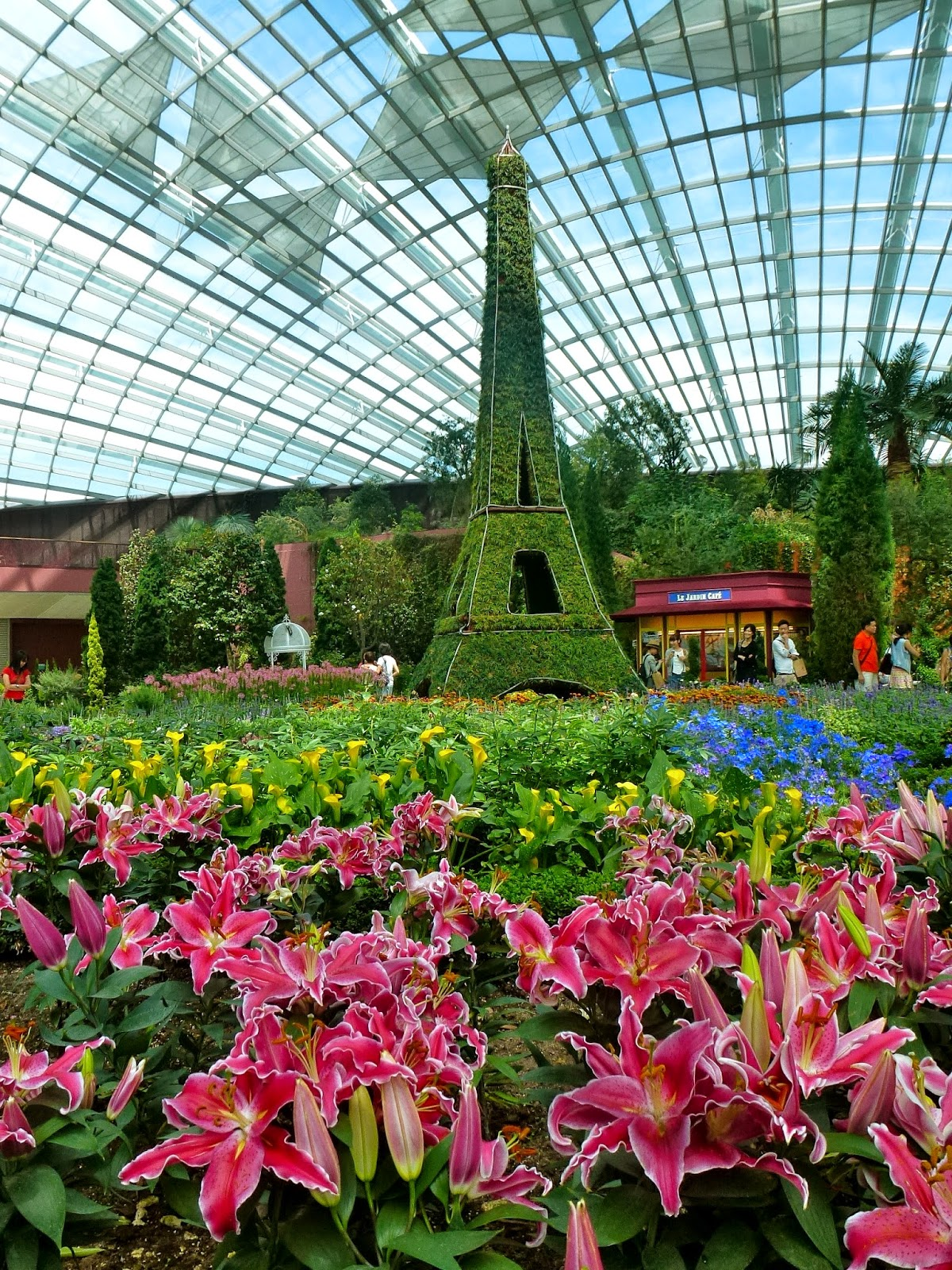French faire at flower dome gardens by the bay all about singapore flower of lily in front of the world most popular structures the eiffel tower which is a 6 metres tall replica izmirmasajfo