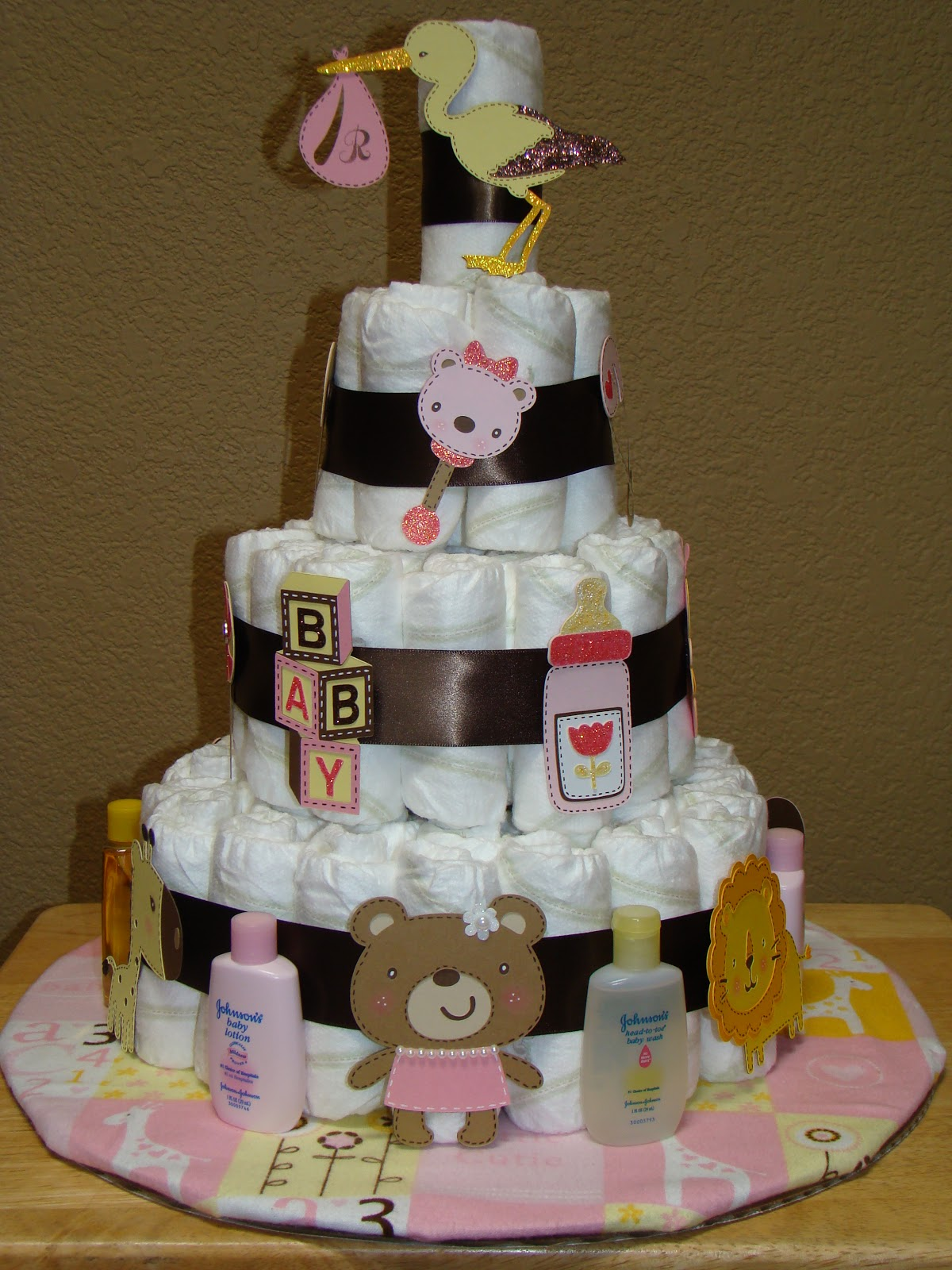 Creating with color by cassandra its a diaper cake well thats it very first diaper cake my pictures dont even come close to how cute it is in person i almost hated to give it away lol publicscrutiny Image collections