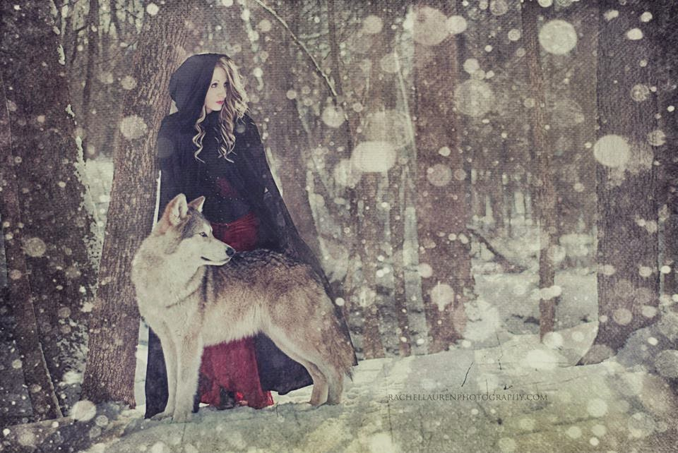 Women and wolves cuddle in beautiful photographs by rachel lauren