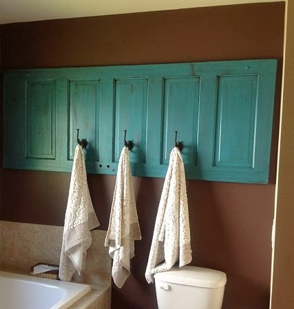 Repurposed door in the bathroom via Pinterest & Dishfunctional Designs: New Looks For Old Salvaged Doors: More ...