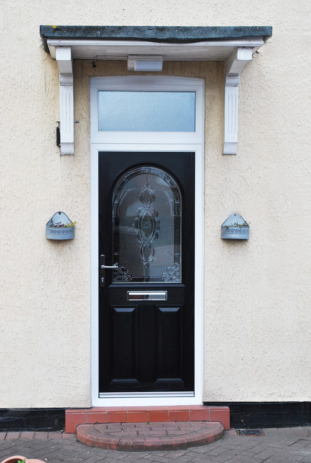 A simple renovation white upvc windows and dovenby black for Upvc windows and doors