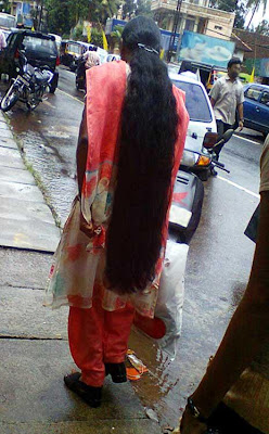 Very long loose hair ponytail.