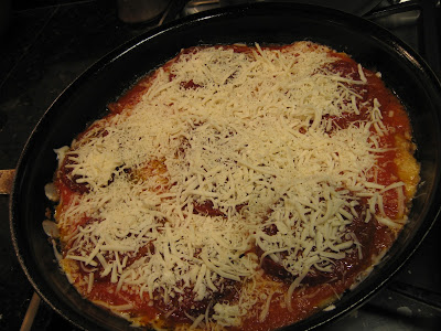 pan with cheese-covered chicken