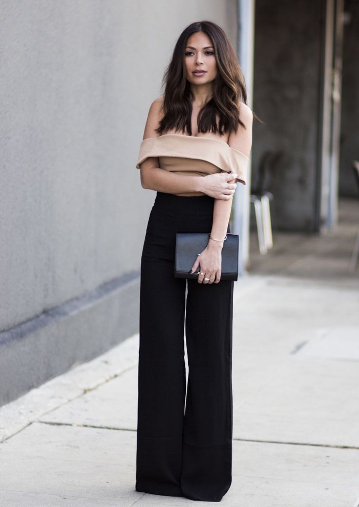 Street style | Black high waist palazzo pants with off the shoulder cream crop top