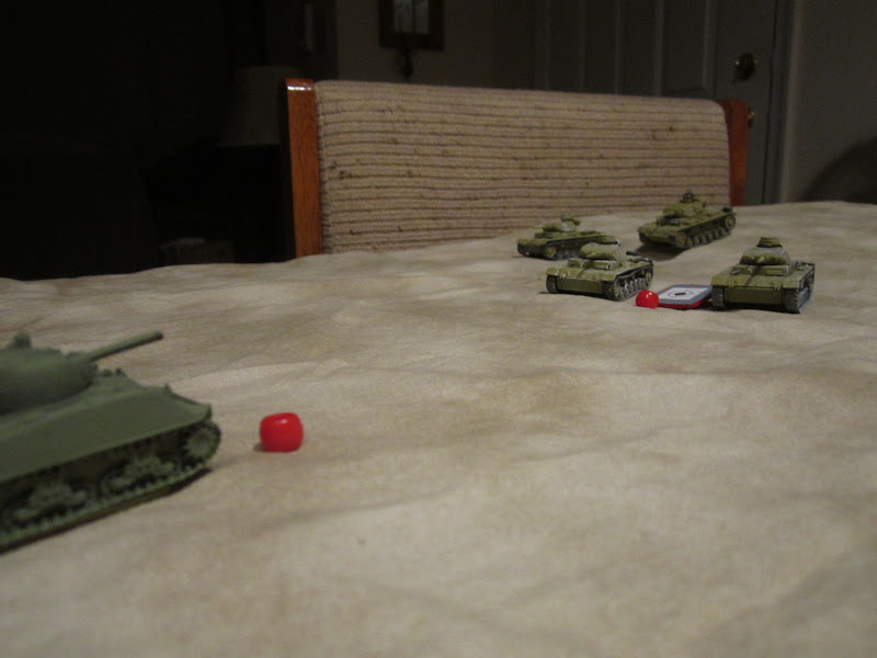 American artillery plots into the lead German tanks advancing into the  title=