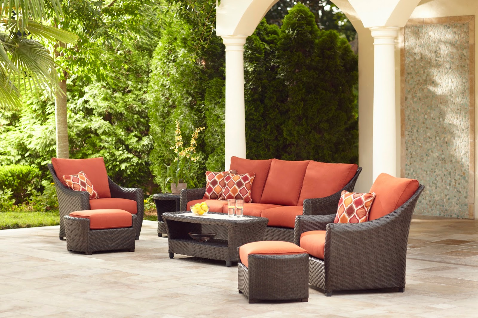the highland collections curved arms and a flared back that project a sense of ease and elegance featuring outdoor seating outdoor chat motion lounge brown jordan northshore patio furniture
