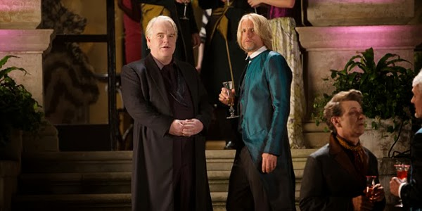 The Hunger Games: Catching Fire (2013) - Plutarch Heavensbee (Philip Seymour Hoffman), Haymitch Abernathy (Woody Harrelson)