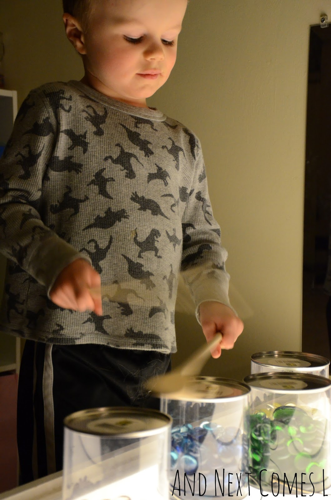 J drumming on the light table from And Next Comes L