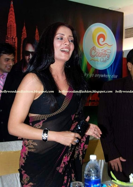 Celina Jaitley - Sexy Sari with low neck blouse