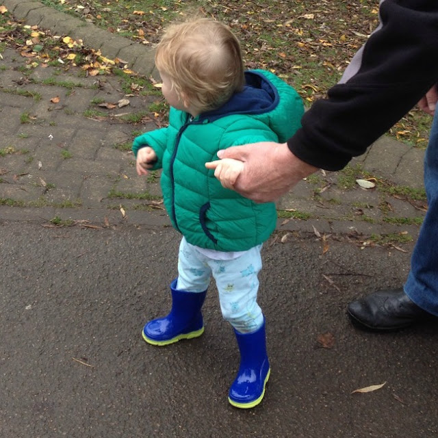 toddler in park wearing his wonderful wellies