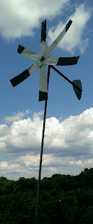 black and white windmill in the sky