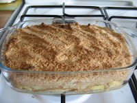 Cooked pear and apple crumble with ginger biscuits and cinnamon