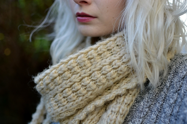 chunky knitted scarf and bright lipstick