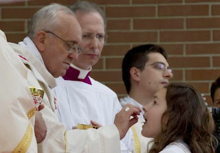 Pope Francis giving communion