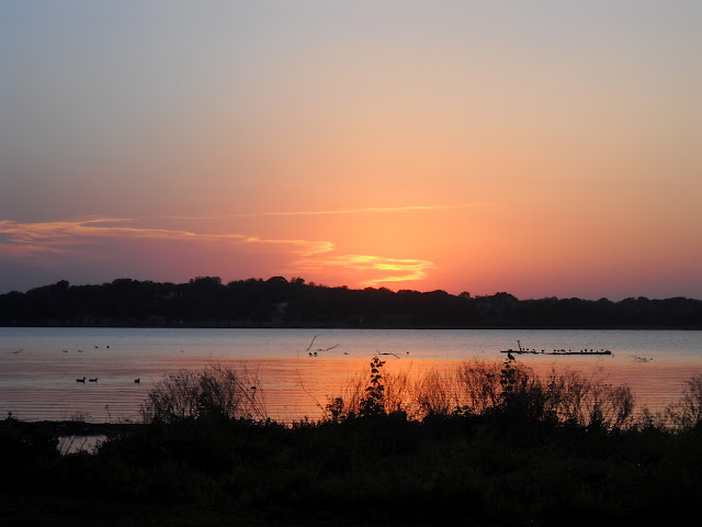White Rock Lake, Dallas glows red as the sun sets