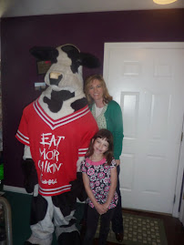 Taylor as the cow for Chick fil A